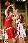 02/11/11--Oregon City's Johanna reaches for a rebound over Clackamas' Natasha Rowland at Clackamas High School..Photo by Jaime Valdez