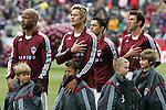 7 April 2007: Colorado players (l to r) Roberto Brown, Mike Petke, Herculez Gomez, abd Jovan Kirovski listen to the national anthem, having lent their warm-up jackets to the youngsters who came out with them for pregame ceremonies. The Colorado Rapids defeated DC United 2-1 at Dick's Sporting Goods Park in Denver, Colorado in the opening game of the MLS regular season.