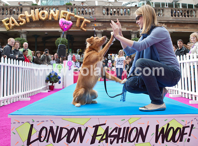 **ALL ROUND PICTURES FROM SOLARPIX.COM**                                             **NO UK NEWSPAPER PUBLICATION**.**UK MAGAZINE & SUPPLEMENT PUBLICATION ONLY** AND NO PUBLICATION IN AUSTRALIA, BELGIUM, FRANCE, GERMANY, ITALY, SCANDINAVIA AND USA**                                                                                  Caption: London Fashion Woof which formed part of Covent Garden's Fashion Fete weekend. London, UK. 20 September 2010                                                                              This pic:  Dog fashion show JOB REF: 12144       SFE       DATE: 20_09_2010                                                            **MUST CREDIT SOLARPIX.COM OR DOUBLE FEE WILL BE CHARGED**                                                                      **MUST AGREE FEE BEFORE ONLINE USAGE**                               **CALL US ON: +34 952 811 768 or LOW RATE FROM UK 0844 617 7637**