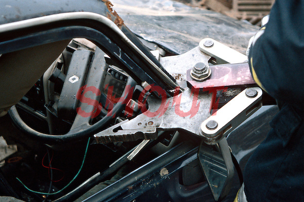 Remains of a car that was stolen by joyriders and was then involved in a RTA. The dashboard and the A post of the vehicle are being cut apart by firefighters using hydraulic cutting tools. This image may only be used to portray the subject in a positive manner..©shoutpictures.com..john@shoutpictures.com