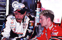 Dale Earnhardt (left) talks with his son, Dale Earnhardt, Jr. in the garage area at Darlington, SC on Friday, 9/1/00, as they prepare for the Pepsi Southern 500 NASCAR race.  (Photo by Brian Cleary/www.bcpix.com)