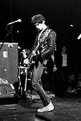 The Stranglers - Jean-Jacques Burnel - performing live performing live on the first of five sold out shows at the Roundhouse in London UK - 02 Nov 1977.  Photo credit: George Bodnar Archive/IconicPix