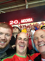 COPY BY TOM BEDFORD MEDIA<br /> Pictured: Matt Evans (C) wth Dad (R) and a friend at a Wales Euro qualifier against Andorra in Cardiff.<br /> Re: Former postman, lotto Millionaire Matt Evans, 35, from Barry, south Wales, who has been spending his winnings to travel the world to watch various sports events.