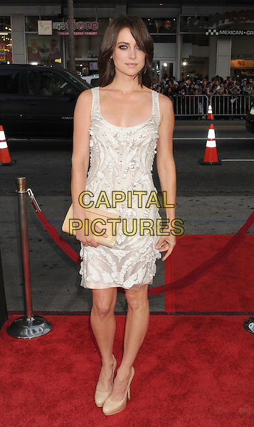 "Jessica Stroup.arriving at the World Premiere of ""Ted"" at Grauman's Chinese Theatre in Hollywood, California, USA, .June 21st, 2012. .full length white sleeveless beaded dress clutch bag .CAP/ROT/TM.©TM/Roth Stock/Capital Pictures"