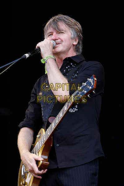CROWDED HOUSE - Neil Finn.Performing live at Hard Rock Calling, Hyde Park, London, England..June 27th, 2010.stage concert live gig performance music half length black shirt guitar singing.CAP/MAR.© Martin Harris/Capital Pictures.