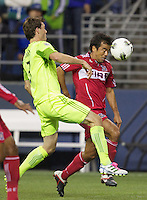 Chicago Fire defender Gonzalo Segares heads the ball which Seattle Sounders FC midfielder Brad Evans defends during play between the Seattle Sounders FC and the Chicago Fire in the U.S. Open Cup Final at CenturyLink Field in Seattle Tuesday October 4, 2011. Seattle won the game 2-0 to win its third U.S. Open Cup.