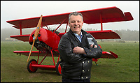 BNPS.co.uk (01202 558833)<br /> Pic: PhilYeomans/BNPS<br /> <br /> Baron Peter von Brueggemann with the Fokker Dreidecker before it was ready to fly.<br /> <br /> The feared Fokker Dreidecker of the Red Baron has finally flown over Britian skies - after British based German doctor 'Baron' Peter von Brueggemann spent 9 years building a replica in his garage.<br /> <br /> The German GP based in Norfolk has spent 9 years building a Fokker triplane as a tribute to infamous WW1 Ace Manfred von Ricthofen, who terrorised the skies over the Western front during the first war.<br /> <br /> Dr Peter Brueggemann, 53, fufilled his childhood dream and emulated the notorious German fighter Ace when his hand built Dreidecker finally took off this week.<br /> <br /> Dr Brueggemann has even acquired the title Baron from the independent territory of Sealand so he can take to the skies as Baron Peter von Brueggemann in homage to his idol.<br /> <br /> The GP at the Holt Medical Practice in Norfolk finally reached for the sky at Felthorpe airfield near Norwich this week in front of nervous friends and family after thousands of hours spent crafting the aircraft.<br /> <br /> The father-of-two, who has lived in England with wife Sue for 20 years, has been taking flying lessons since his project began.