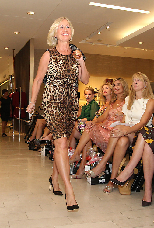 BOSTON -- Anne McGuire, wife of Boston Red Sox bullpen coach Gary Tuck, walks the runway during the From Fenway to the Runway charity fashion show benefitting the Red Sox Foundation at Saks Fifth Avenue on Thursday, Sept. 13, 2012. (Brita Meng Outzen/Boston Red Sox)