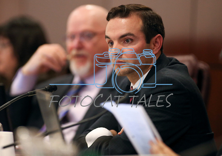 Nevada Assemblyman Derek Armstrong, R-Henderson, works in committee at the Legislative Building in Carson City, Nev., on Tuesday, Feb. 10, 2015. <br /> Photo by Cathleen Allison