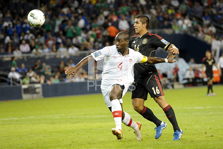 Nana Attakora-Gyan (4) Canada holds off Miguel Ponce (16) Mexico... Mexico defeated Canada 3-1 in Olympic Qualifying semi final at LIVESTRONG Sporting Park, Kansas City, Kansas.