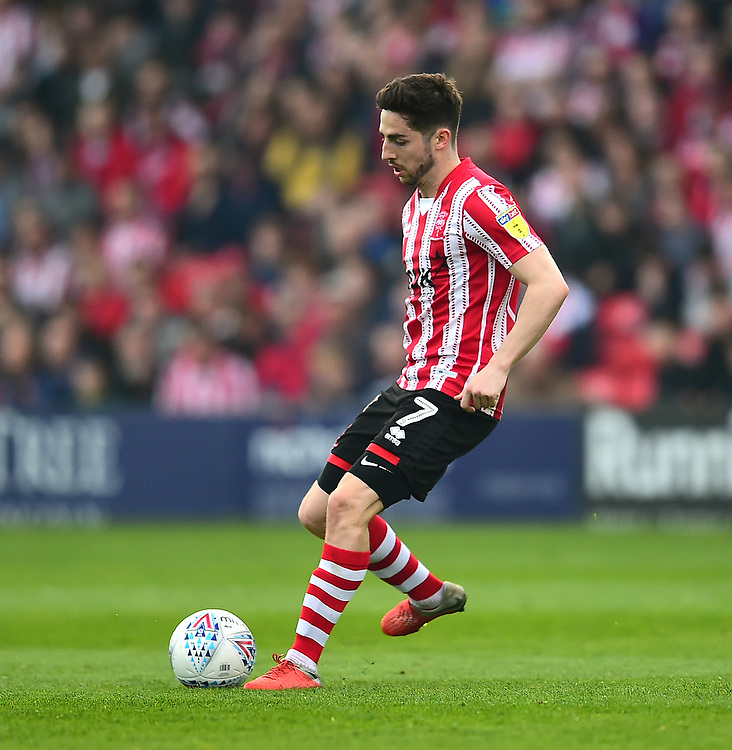 Lincoln City's Tom Pett<br /> <br /> Photographer Andrew Vaughan/CameraSport<br /> <br /> The EFL Sky Bet League Two - Lincoln City v Macclesfield Town - Saturday 30th March 2019 - Sincil Bank - Lincoln<br /> <br /> World Copyright © 2019 CameraSport. All rights reserved. 43 Linden Ave. Countesthorpe. Leicester. England. LE8 5PG - Tel: +44 (0) 116 277 4147 - admin@camerasport.com - www.camerasport.com