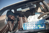 November 22, 2014 - Murzuq, Libya: Tebu tribal men in Murzuq. Fighting around Southwest Ubari region ignited after Tuareg militias from Mali and Libya sized control over the vast oilfield installations aligned with the Third Force of Misrata armed forces. Since then raged battles have taken place between two factions: one faction of Tuareg fighters lead by Third Force from Misrata pushing to clean the region from the other faction of Tebu tribal fighters defending their controlled territory. (Photo/Narciso Contreras)