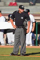 Home plate umpire Jeremy Riggs between innings of an Appalachian League game between the Greeneville Astros and the Bristol White Sox at Boyce Cox Field July 1, 2010, in Bristol, Tennessee.  Photo by Brian Westerholt / Four Seam Images