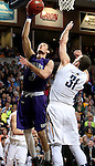 SIOUX FALLS, SD - FEBRUARY 27:  Mack Johnson #3 from the University of Sioux Falls lays the ball up against Alex Richter #31 from Augustana during their NSIC Tournament game Saturday night at the Pentagon in Sioux Falls. (Photo by Dave Eggen/Inertia)