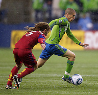 Seattle Sounders FC midfielder Osvaldo Alonso dribbles in front of Real Salt Lake midfielder Kyle Beckerman during play in a Major League Soccer Wester Conference Semifinal match at CenturyLink Field in Seattle Wednesday November 2, 2011. The Sounders won the match 2-0, but lost the series.