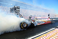Oct. 29, 2011; Las Vegas, NV, USA: NHRA top fuel dragster driver Clay Millican during qualifying for the Big O Tires Nationals at The Strip at Las Vegas Motor Speedway. Mandatory Credit: Mark J. Rebilas-