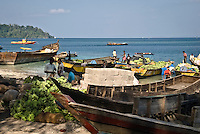 At the beach of Havelock Island, early in the morning the dugouts and other wooden boats are loading their cargo of fruit, vegetables, fish, goods and building material to bring it to the other islands