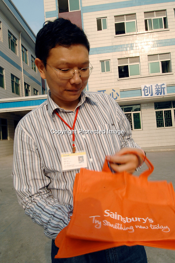 Mr Liu at the Richall factory that makes woven plastic bags can be used many times and are seen as environmentally friendly. The comapny makes plastic bags for several clients including Disney and Sainsbury's.<br /> <br /> Photo by Richard Jones / Sinopix