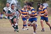Alipeni Olosoni is all determination as he tries to run ound Sami Fisilau. Counties Manukau Premier Club Rugby game between Manurewa and Patumahoe played at Mountfort Park Manurewa on Saturday 3rd April 2010..Patumahoe won 26 - 8 after leading 14 - 3 at halftime.