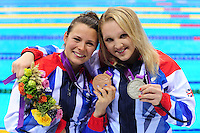 PICTURE BY ALEX BROADWAY /SWPIX.COM - 2012 London Paralympic Games - Day Seven - Swimming, Aquatic Centre, Olympic Park, London, England - 05/09/12 - Elizabeth Johnson & Charlotte Henshaw of Great Britain pose with their medals after the Women's 100m Breaststroke SB6 Final.