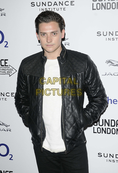 "Aneurin Barnard.attended the ""Emanuel & The Truth About Fishes"" UK film premiere, the Sundance London 2013 film & music festival day 2, Cineworld cinemas, The O2, Peninsula Square, London, England, UK, .26th April 2013..half length black leather jacket quilted hands in pockets white top t-shirt .CAP/CAN.©Can Nguyen/Capital Pictures."