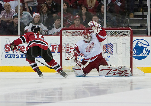 December 5, 2009: Detroit Red Wings' Chris Osgood #30 makes a save during an overtime shoot out against New Jersey Devils' Travis Zajac #19 during the regular season game between the New Jersey Devils and the Detroit Red Wings at Prudential Center in Newark, New Jersey. Photo by Michael Bucher/Actionplus. UK Licenses only.