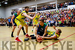 Goran Pantovic looks for Kieran Donaghy as UCD Marian surround him during their game last Saturday night in the Tralee Sports Complex.