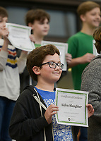 NWA Democrat-Gazette/CHARLIE KAIJO Aiden Slaughter (center) holds up a certificate for achieving straight As during an awards assembly, Friday, January 11, 2019 at the Arkansas Arts Academy in Rogers. <br />