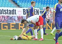 16th May 2020, Red Bull Arena, Leipzig, Germany; Bundesliga football, Leipzig versus FC Freiburg; Goalkeeper Alexander Schwolow SCF on the ground after colliding with Patrik Schick RBL