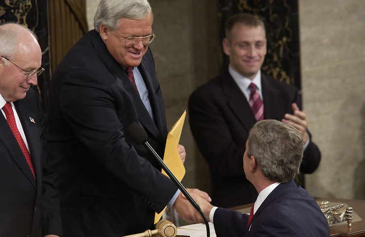 Vice President Dick Cheney and Speaker of the House Dennis Hastert, R-Ill., greet President George W. Bush before the State of the Union address.