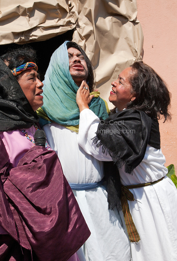 Lazarus and his two Sisters, Mary and Martha, Rejoicing as he Comes out of the Tomb.  (John 11).  Palm Sunday Re-enactment of events in the life of Jesus, by the group called Luna LLena (Full Moon), a group of volunteers in Antigua, Guatemala.