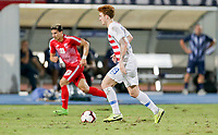 GEORGETOWN, GRAND CAYMAN, CAYMAN ISLANDS - NOVEMBER 19: Josh Sargent #19 of the United States moves with the ball during a game between Cuba and USMNT at Truman Bodden Sports Complex on November 19, 2019 in Georgetown, Grand Cayman.