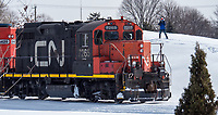 Point Edward's Marc Dease's doesn't let bitter cold temperatures discourage him from his passion for trains and boats. Dease has been shooting pictures of Great Lakes freighters for the past 30 years and in the last five years has been documenting trains. He's seen here at Centennial Park waiting in minus -17C temperatures for the perfect moment as a train hauling grains from Cargill passes by.