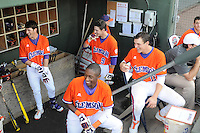 Members of the Clemson Tigers, including clockwise from left Steve Wilkerson, Steven Duggar, Shane Kennedy, and Maleeke Gibson, share a laugh in the dugout prior to a game against the Furman Paladins on Wednesday, May 8, 2013, at Fluor Field at the West End in Greenville, South Carolina. (Tom Priddy/Four Seam Images)