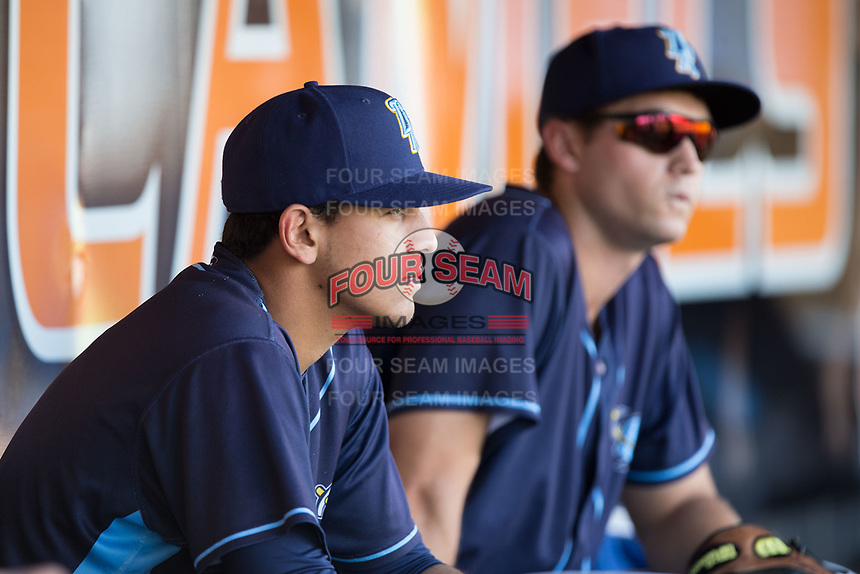 Nicky Lopez (left) sits in the dugout prior to the game against the Buies Creek Astros at Jim Perry Stadium on April 29, 2017 in Buies Creek, North Carolina.  The Astros defeated the Blue Rocks 3-0.  (Brian Westerholt/Four Seam Images)