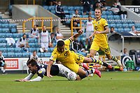 Tom Bradshaw of Millwall goes down in the penalty area under the challenge of Ben Cabango of Swansea City during Millwall vs Swansea City, Sky Bet EFL Championship Football at The Den on 30th June 2020