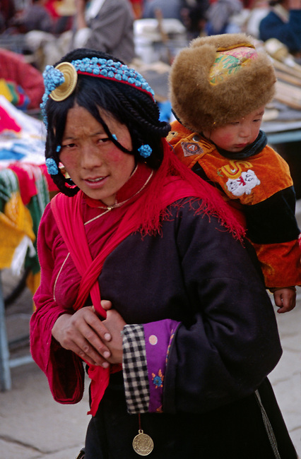TIBETAN MOTHER & CHILD circumambulate the Jokhang Temple along the BARKOR (TIBETAN Bazaar) - LHASA, TIBET