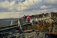 suspension bridge, North Carolina, NC, Women walking across Mile High swinging bridge at Grandfather Mountain in the fall.