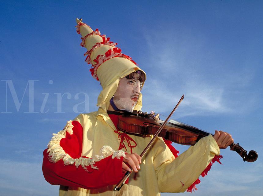 CAJUN MARDI GRAS MUSICIAN (11) PLAYING THE VIOLIN. MARDI GRAS MUSICIAN. EUNICE LOUISIANA.