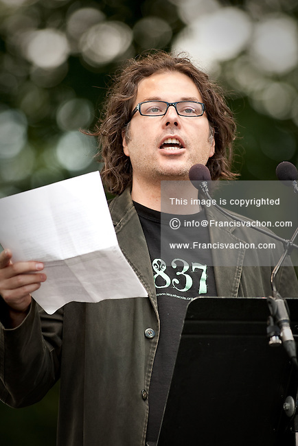 Reseau de resistance du Quebecois (RRQ) leader Patrick Bourgeois reads a text  during the Moulin a Paroles held on the Plains of Abraham in Quebec city September 13, 2009.