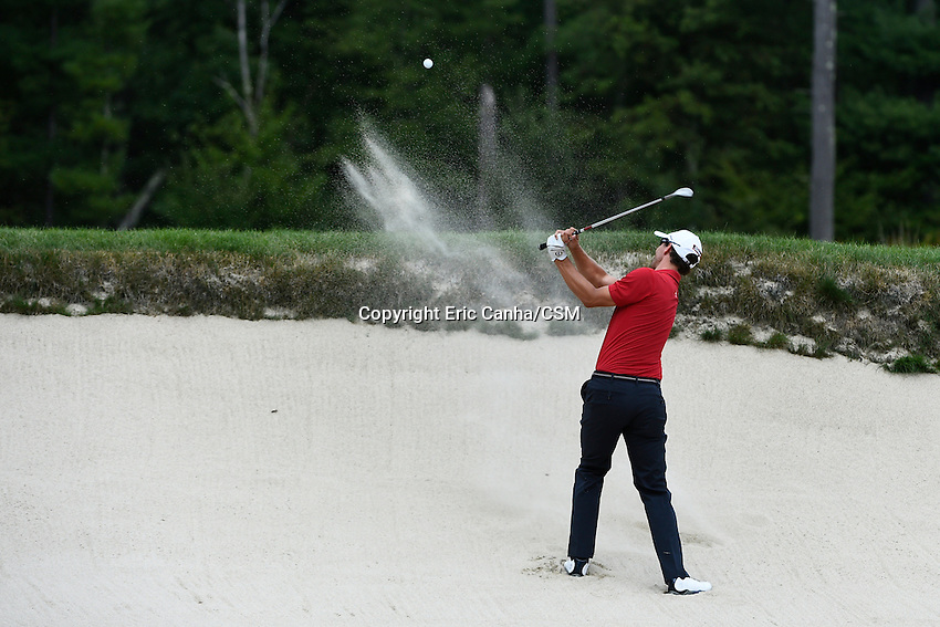 August 31, 2014 -  Norton, Mass. -  Adam Scott hits his way out of a sand trap on the 4th hole during the third  round of the PGA FedEx Cup playoffs, Deutsche Bank Championship, held at the Tournament Players Club in Norton Massachusetts. Eric Canha/CSM