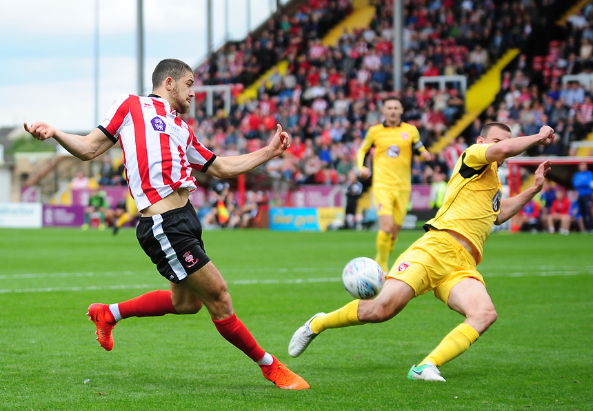 Lincoln City's Sean Long vies for possession with Morecambe's Dean Winnard<br /> <br /> Photographer Andrew Vaughan/CameraSport<br /> <br /> The EFL Sky Bet League Two - Lincoln City v Morecambe - Saturday August 12th 2017 - Sincil Bank - Lincoln<br /> <br /> World Copyright &copy; 2017 CameraSport. All rights reserved. 43 Linden Ave. Countesthorpe. Leicester. England. LE8 5PG - Tel: +44 (0) 116 277 4147 - admin@camerasport.com - www.camerasport.com