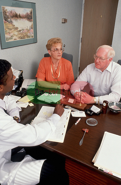 Mature couple consults with physician during office visit