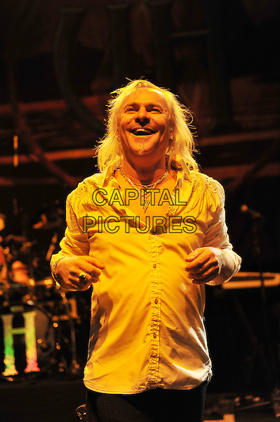 Bernie Shaw.Uriah Heep performing live in concert, Shepherd's Bush Empire, London, England. .8th December 2011.on stage gig performance music half length white shirt smiling .CAP/MAR.© Martin Harris/Capital Pictures.