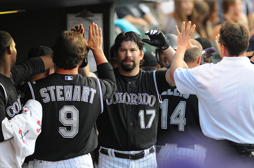 20 JULY 2011: Colorado Rockies first baseman Todd Helton (17) celebrates a two-run homerun in the dugout with teammates during a regular season game between the Atlanta Braves and the Colorado Rockies at Coors Field in Denver, Colorado. Rockies walked off against the Braves, winning 3-2 in 9 innings. *****For Editorial Use Only*****