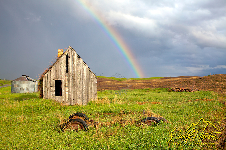 Rainbow over old homestead