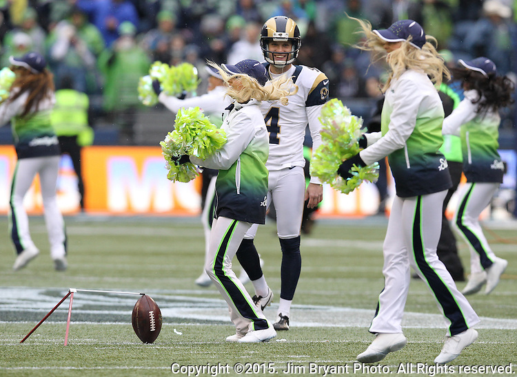 St. Louis Rams kicker Greg Zuerlein (4) has his field goal practice interrupted by the Seagal performance during halftime of their game against  the Seattle Seahawks  at CenturyLink Field in Seattle, Washington on December 27, 2015.  The Rams beat the Seahawks 23-17.      ©2015. Jim Bryant Photo. All Rights Reserved