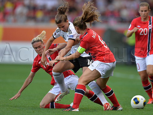 17.07.2013. Kalmar, Sweden.  Melanie Leupolz (c) of Germany challenges for the ball with Gry Tofte Ims and Maren Mjelde (r) of Norway during the UEFA Women's EURO 2013 Group B soccer match between Germany and Norway at the Kalmar Arena in Kalmar, Sweden, 17 July 2013.