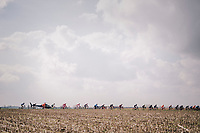 peloton in the open fields<br /> <br /> Driedaagse Brugge-De Panne 2018<br /> Bruges - De Panne (202km)