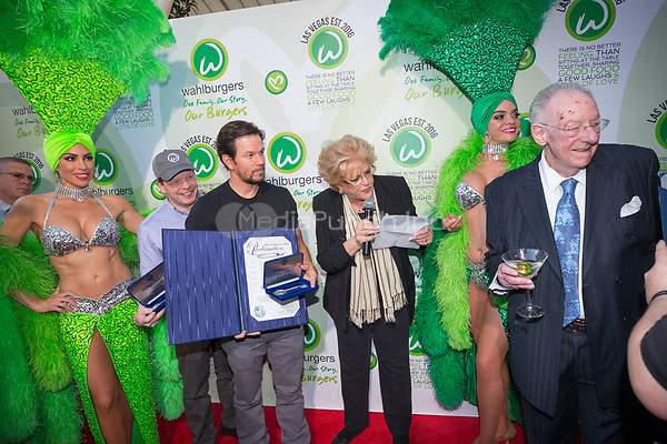 LAS VEGAS, NV - March 28, 2017: ***HOUSE COVERAGE***  Paul Wahlberg, Mark Wahlberg, Mayor Carolyn Goodman, Former Mayor Oscar Goodman pictured with a Proclomation declaring Wahlburgers Day in Las Vegas as Mark and Paul Wahlberg attend event at Wahlburgers at The Grand Bazaar Shops at Bally's in Las vegas, NV on March 28, 2017. Credit: Erik Kabik Photography/ MediaPunch